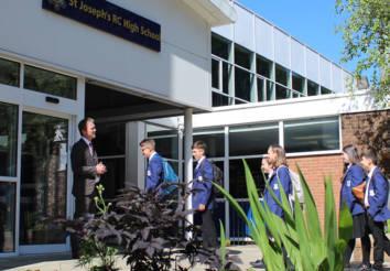 Pupils arriving at the school entrance.